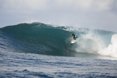 Ben Lacy tucked in high at Salani Rights, Samoa. Photo: Derek Morrison