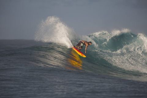 Surf guide Brian Wilson laying the rail in, Salani Rights, Samoa. Photo: Derek Morrison