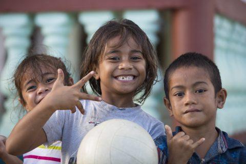 Local kids Marina (left) and Taiti all smiles in Salani village, Samoa. Photo: Derek Morrison