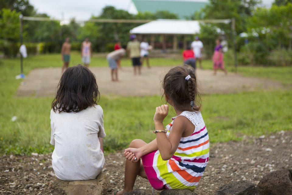 Local girls watch an impromptu volleyball game in Salani. Photo: Derek Morrison