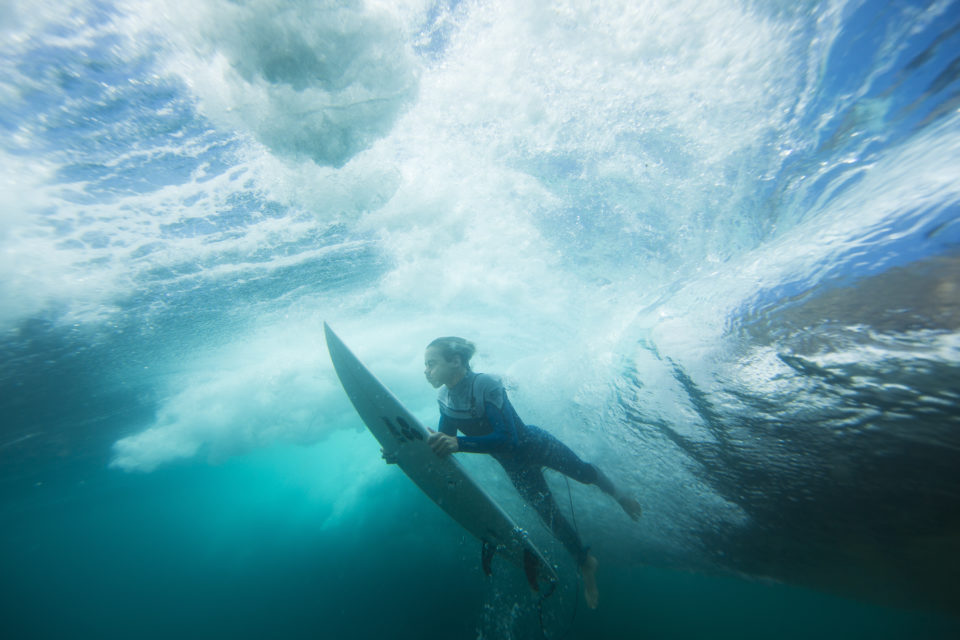 A surfer pushes through a wave in fun conditions at LA  on the Northern beaches of Sydney, NSW, Australia.