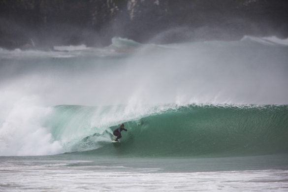 """Australian singer songwriter Ziggy Alberts taking some time out to get """"the barrel of his life"""" at a remote beach in the Catlins. Photo: Derek Morrison"""