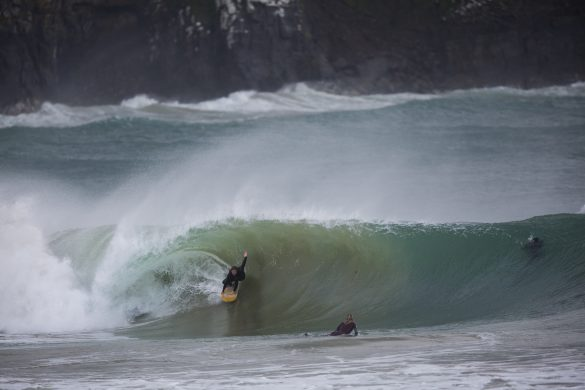Bede Carmine drives through a hollow section at a remote beach in the Catlins. Photo: Derek Morrison