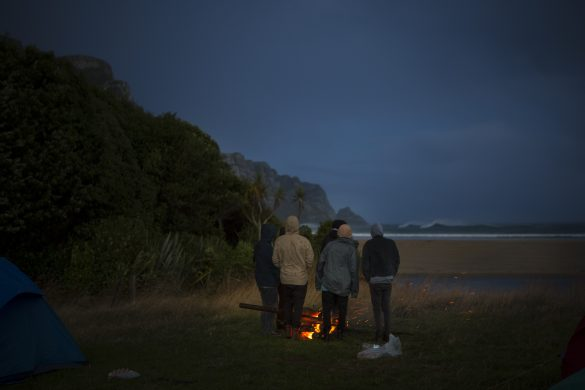Campfire in the rain at a remote beach in the Catlins. Photo: Derek Morrison