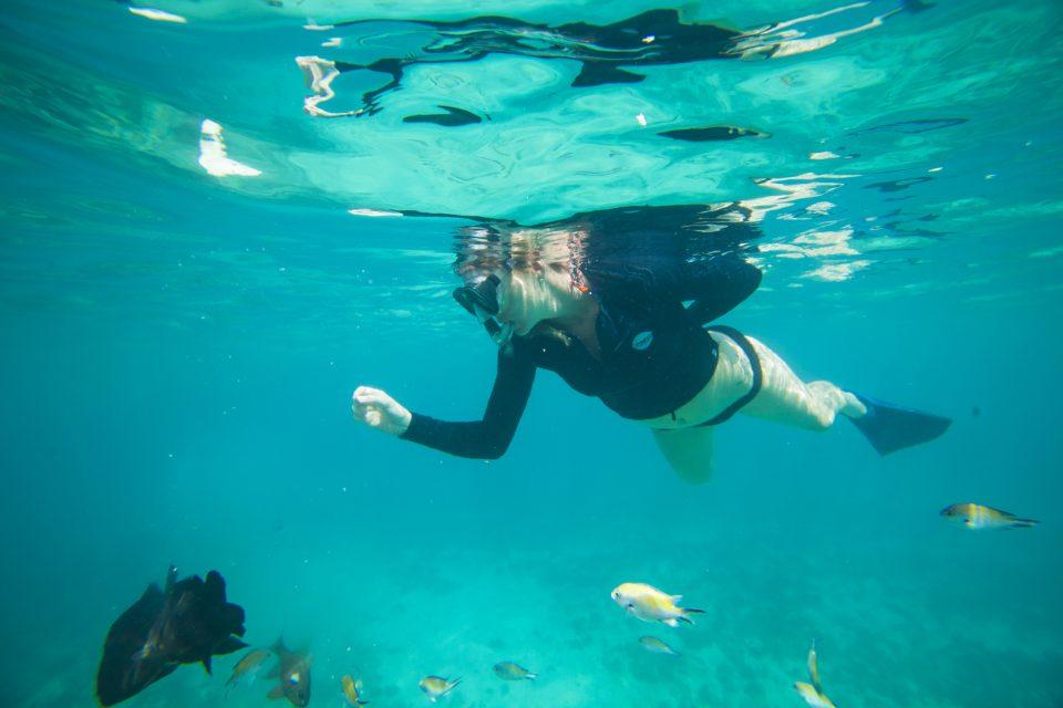 Local surfer Emily Ryves snorkelling in the lagoon. Photo: Derek Morrison