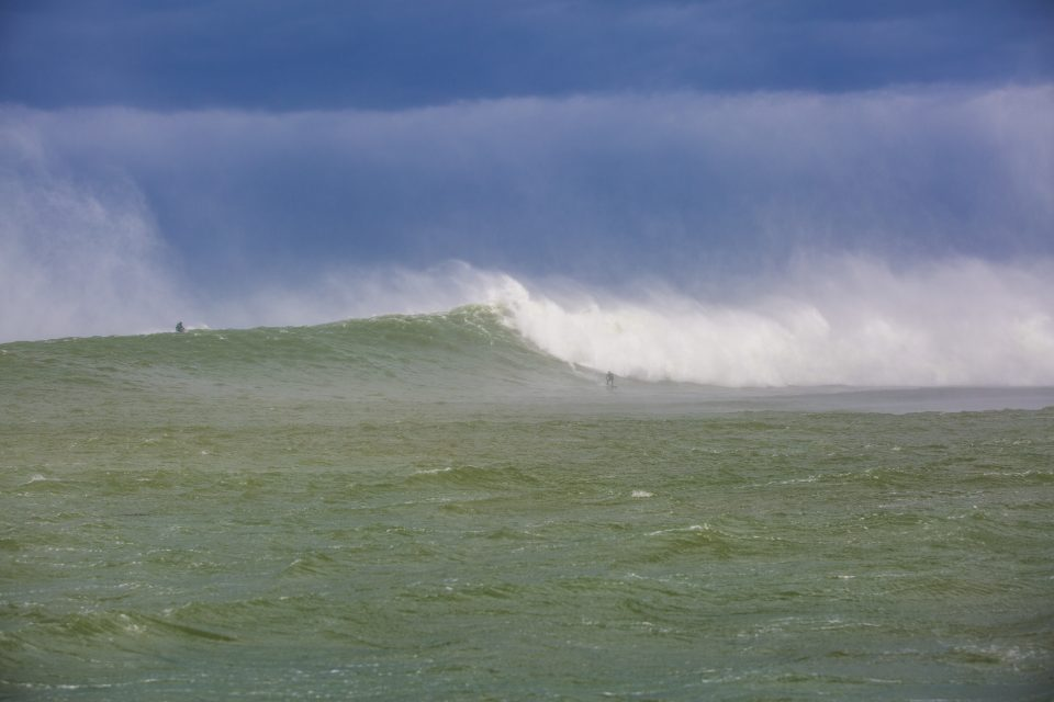 Doug Young on one of the biggest wildest sets during the storm swell. Photo: Derek Morrison