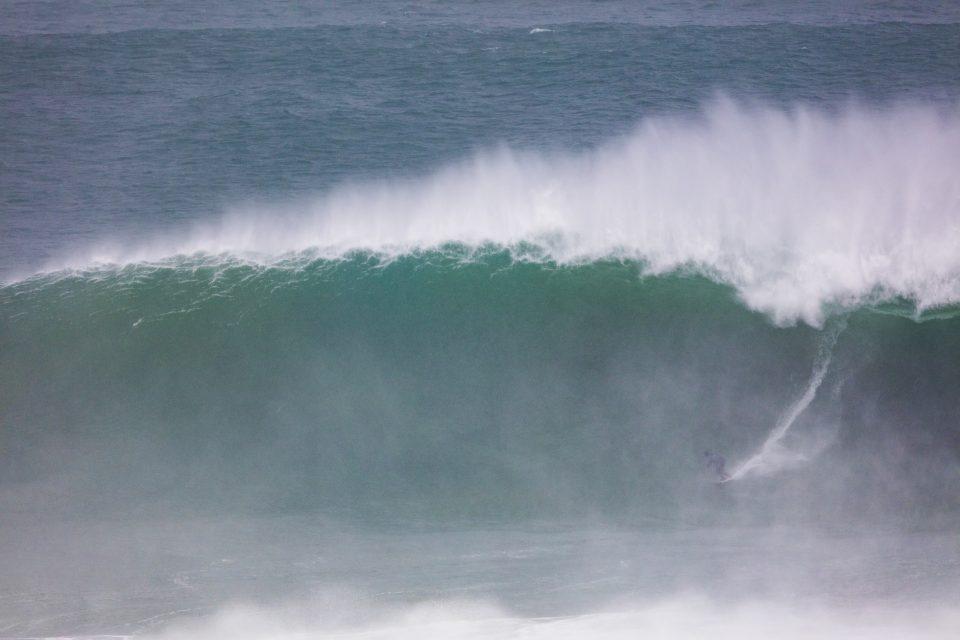 Dan Smith on a rain-cloaked wave. Photo: Derek Morrison