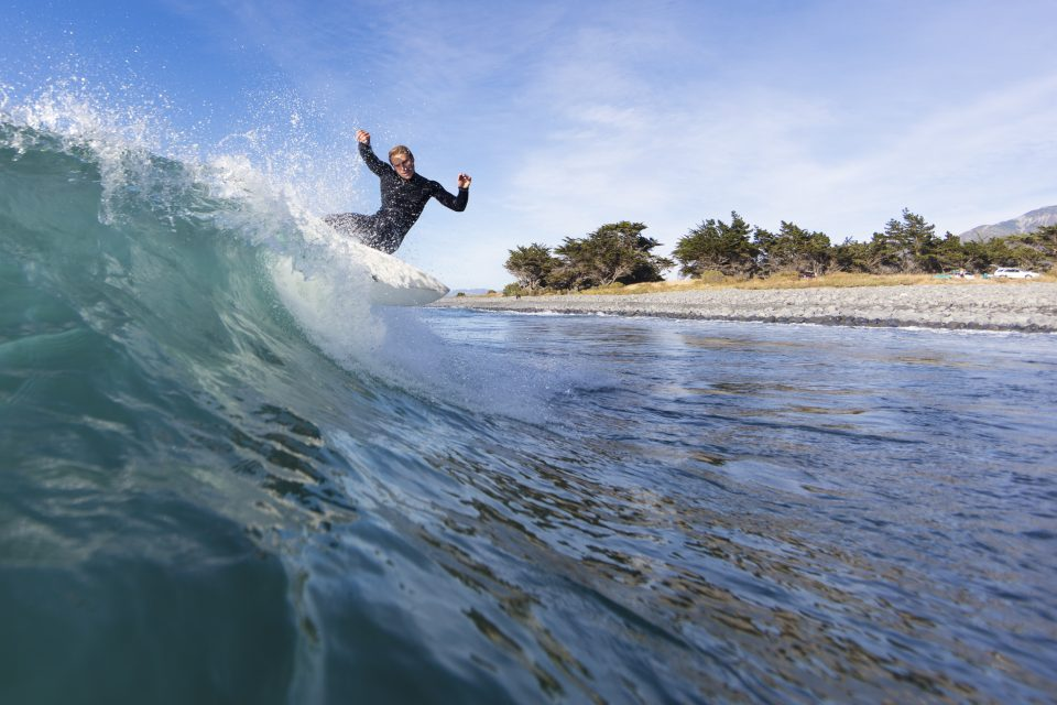 Levi O'Connor makes the most of clean, small waves at Kaikoura. Photo: Derek Morrison
