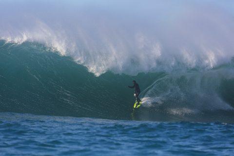 Oscar Smith rides a barrel at a remote reefbreak near Dunedin, New Zealand. Photo: Derek Morrison