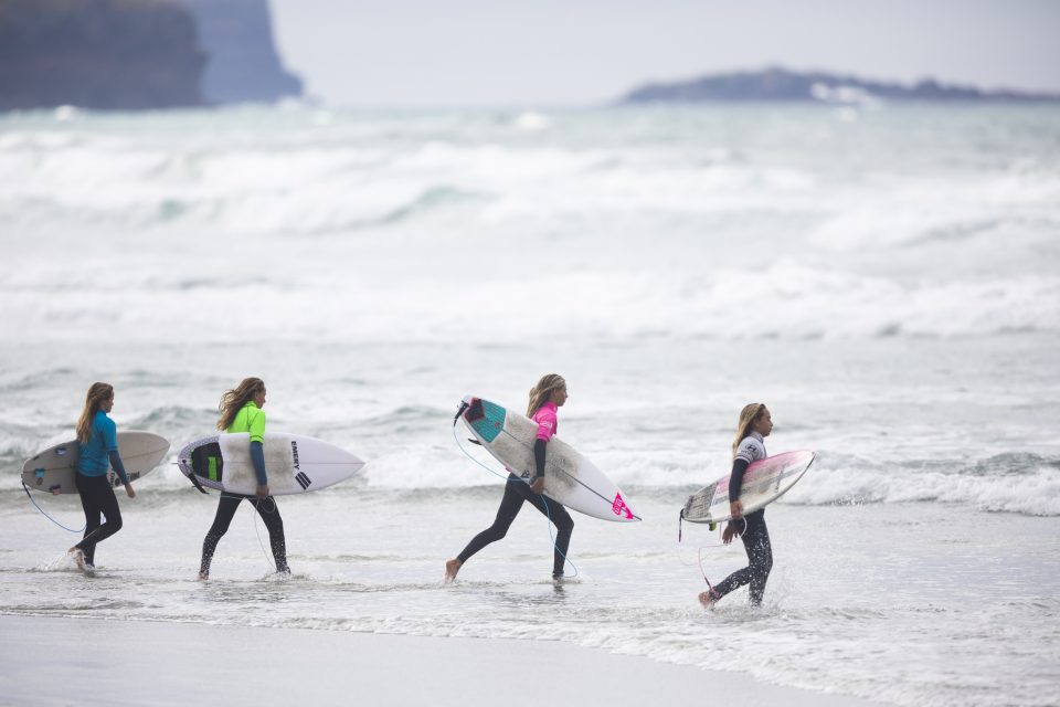 The under 20 girl's finalists head out during the 2019 Emerson's Brewery South Island Surfing Championships held at St Clair, Dunedin, New Zealand. Photo: Derek Morrison