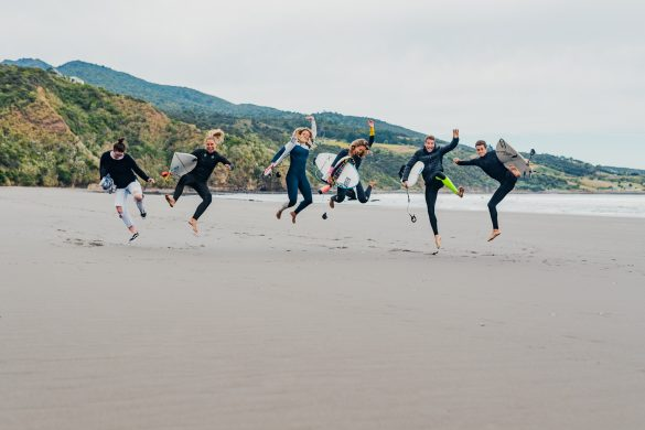 Paige Hareb and friends make the most of the days before lockdown on the beach at Ngarunui, Raglan. Photo: RiBLANC