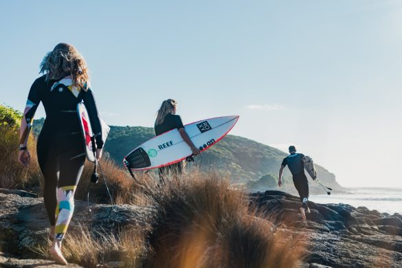 Tristan Guilbaud, of France, Ellie Brooks, of Australia, and Pauline Ado, of France skip across the rocks to Indies. Photo: RiBLANC
