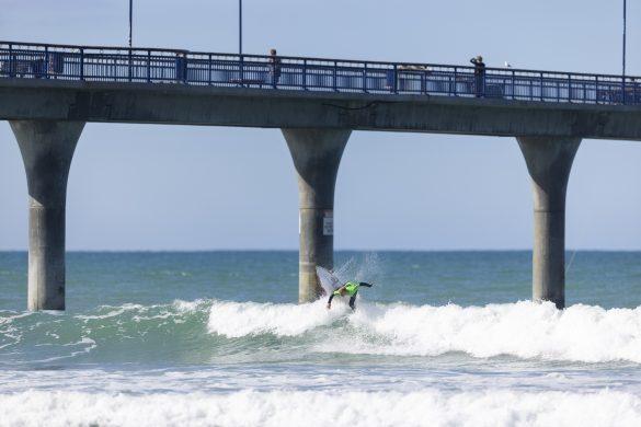 Kaikoura surfer Tyler Perry under the pier. Photo: Derek Morrison